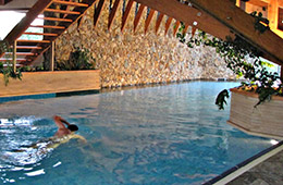 man swimming in indoor pool